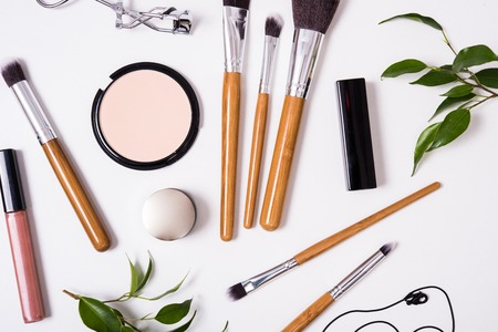 Photo pour Professional makeup brushes and tools, make-up products kit, flatlay on white background - image libre de droit