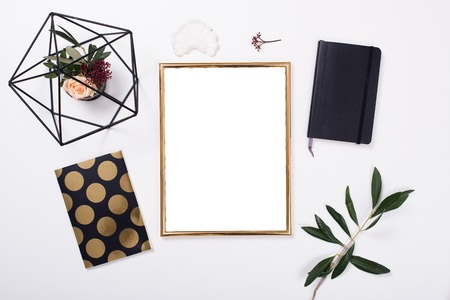 Photo for Golden frame mock-up on white tabletop - Royalty Free Image