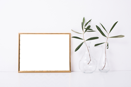 Photo pour Golden frame mock-up on white wall - image libre de droit