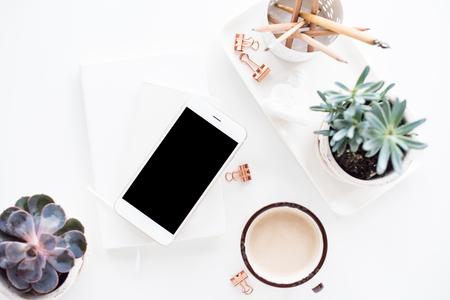 Foto de office desk flat lay with coffe, smartphone and succulents, clea - Imagen libre de derechos