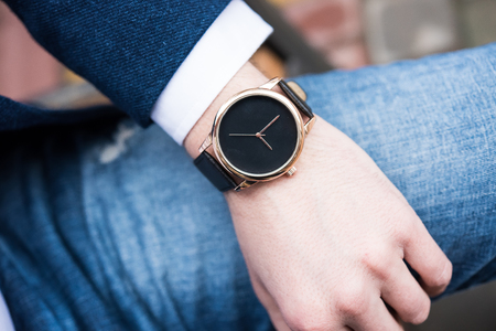 Photo for Elegant young business mans hand with fashion no brand wrist watch - Royalty Free Image
