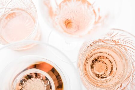 Photo for Sparkling rose wine in different glasses on white background - Royalty Free Image