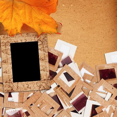 Foto de Set of old vintage slides, photos and film with autumn leaf  in grunge paper album - Imagen libre de derechos