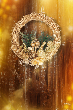 Foto de Christmas golden wreath on old abstract background with neon light and bokeh - Imagen libre de derechos
