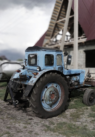Photo pour Old Tractor. Rural landscape. - image libre de droit