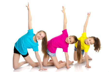 Photo for A group of girls gymnasts perform exercises. - Royalty Free Image