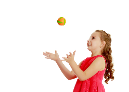 Photo for The little girl throws the ball up - Royalty Free Image