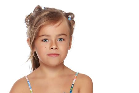 Photo pour Tanned little girl in a swimsuit - image libre de droit