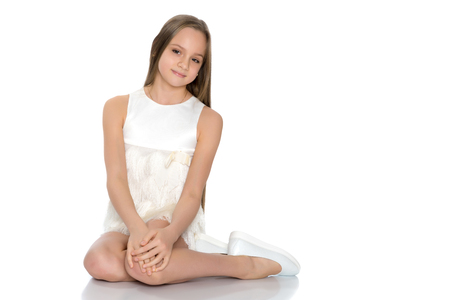 Photo for A teenage girl is sitting on the floor. - Royalty Free Image