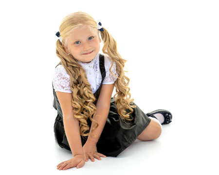 Foto de Little girl is sitting on the floor. - Imagen libre de derechos