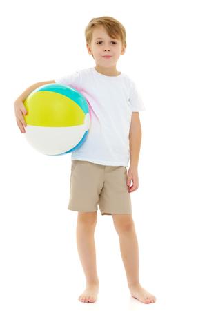 Photo pour A little boy is playing with a ball. - image libre de droit