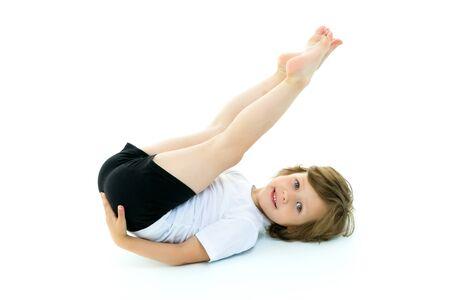 Photo pour Charming little girl doing gymnastic exercises in the studio on - image libre de droit
