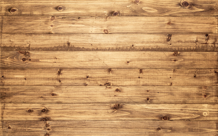Photo pour Light brown wood texture background viewed from above. The wooden planks are stacked horizontally and have a worn look. This surface would be great as design element for a wall, floor, table etc… - image libre de droit