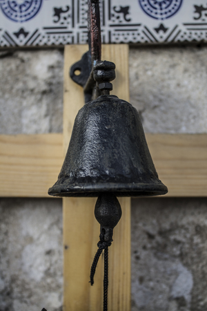 Foto de typical black maritime bell and wooden clapper - Imagen libre de derechos