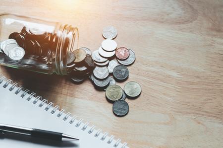 Foto de concept saving money business finance with pen and notebook - Imagen libre de derechos