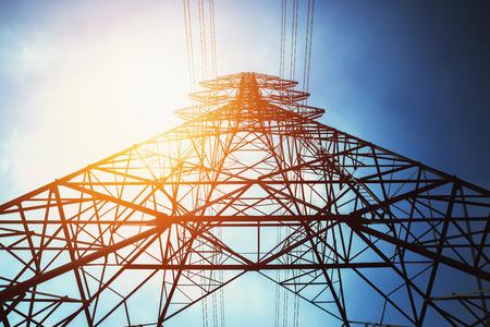 Foto de high voltage tower with solar energy background - Imagen libre de derechos