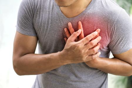 Foto de A man having heart attack. Healthcare concept - Imagen libre de derechos