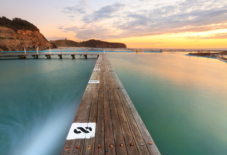 North Narrabeen Tidal Pool from Lane 8, Narrabeen Beach Sydney, Australia, at sunrise. Focus to foreground
