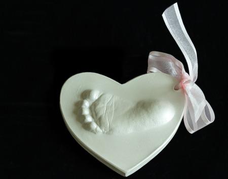Foto für The cast of a baby's footprint - Lizenzfreies Bild