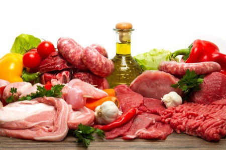 Fresh butcher cut meat assortment garnished