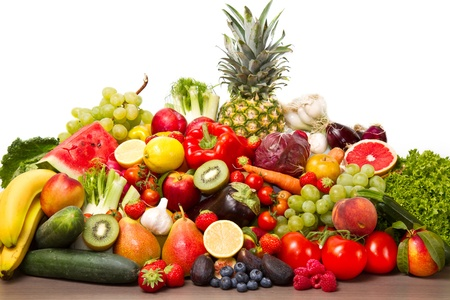 Fruits and vegetables like tomatoes, zucchini, melons, bananas and grapes arranged in a group
