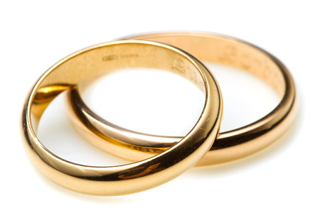 Foto de couple of gold wedding rings on white background - Imagen libre de derechos