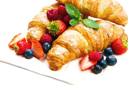 Foto de Croissants and fresh fruit for breakfast - Imagen libre de derechos