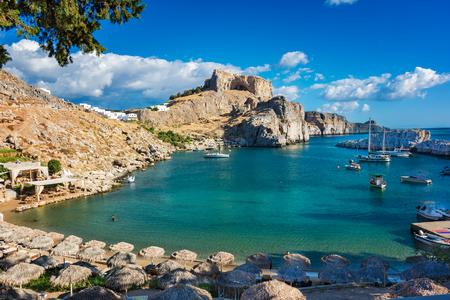 Foto de Beautiful St. Paul´s bay with boats, Lindos acropolis in background (Rhodes, Greece) - Imagen libre de derechos