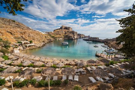 Foto de St. Paul  bay with boats, Lindos acropolis in background (Rhodes, Greece) - Imagen libre de derechos