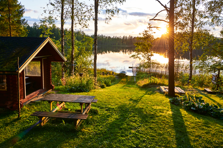 Foto de The lakes in Finland are a great place to spend the summer holidays with the whole family - Imagen libre de derechos
