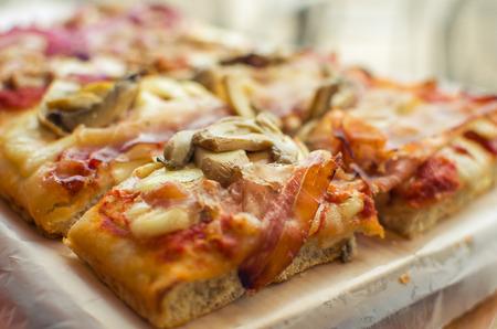 Photo pour tasty pizza cut into small squares italian food - image libre de droit
