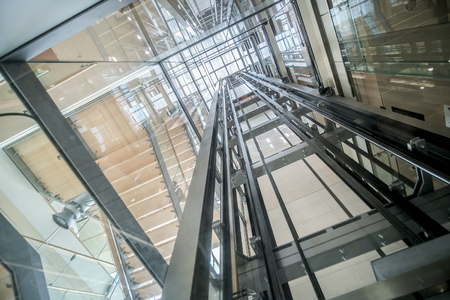 Photo for transparent lift modern elevator shaft glass building - Royalty Free Image