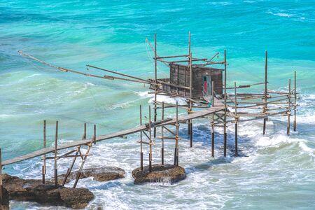 Foto de Trabocchi coast of Punta Aderci in Vasto - Abruzzo region - Chieti province- trabucco or trabocco is old wooden palatiffe stilt house shack fishing machine south italy sea - Imagen libre de derechos