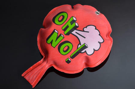 Photo pour red rubber whoopee cushion with reflection on black glass - image libre de droit