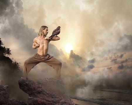 Man practices martial arts with bird of prey at dawn