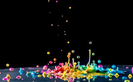 Foto de splashing color ink on black background - Imagen libre de derechos