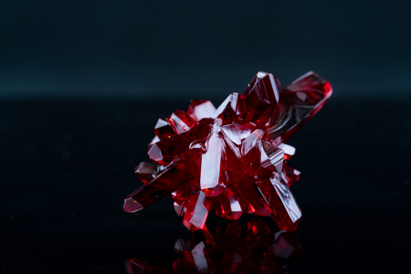 Photo for red crystal of natural origin. close up of crystals in ruby color on black background - Royalty Free Image