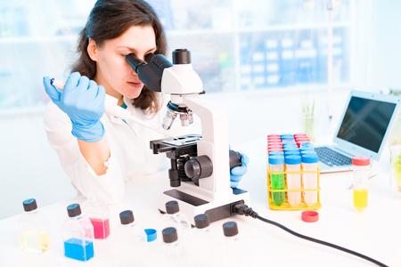 Foto de Young female technician in the laboratory of food quality control - Imagen libre de derechos