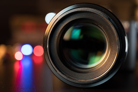 Photo pour The photo or videocamera lens on dark background with lense reflections - image libre de droit