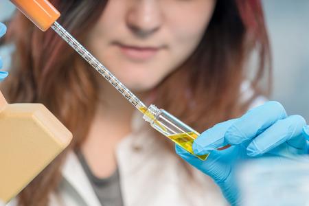 Foto de pretty female laboratory assistant analyzing a biological  sample at hospital - Imagen libre de derechos