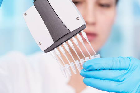 Foto de Young woman with genetic research in the laboratory research of cancer diseases - Imagen libre de derechos