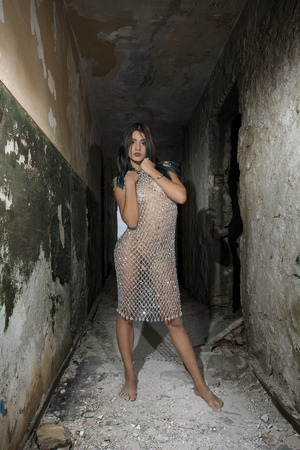 Foto de Young girl posing in a silver fishnet dress - Imagen libre de derechos