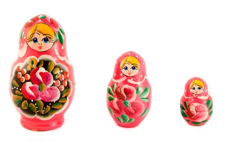 Three Russian dolls over white