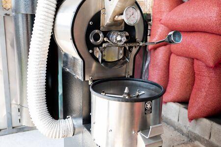 Foto de Coffee grinders and coffee bean sacks are stored in the coffee shop. - Imagen libre de derechos