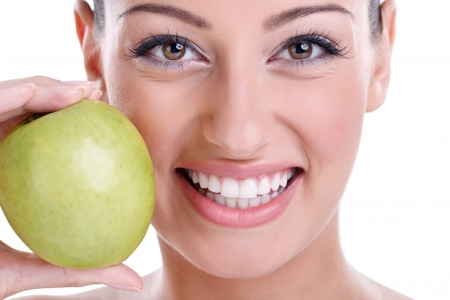 great healthy smile with green apple