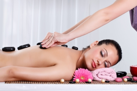 Photo for Beautiful woman receiving hot stone massage at spa and wellness center - Royalty Free Image