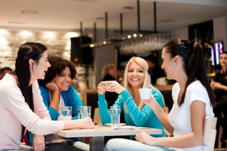 Photo pour group of young women on coffee break, enjoying in discussion - image libre de droit