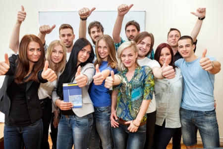 Foto de  Group of students at the university with thumbs up - Imagen libre de derechos