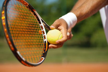 Photo pour  Close up of a tennis player standing ready for a serve - image libre de droit