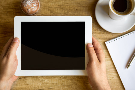 Photo pour  coffee break with web surfing, digital tablet in male hands - image libre de droit